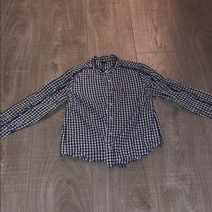 I am selling a black and white button down
